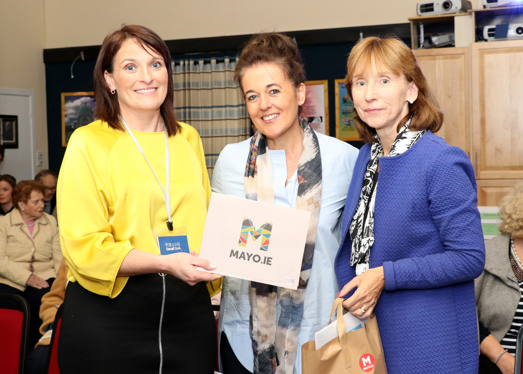 Sarah Togher presenting to Syliva McCarthy and Bernie O'Brien.